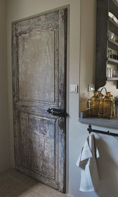 Love the use of antique doors inside like for a pantry door.