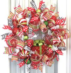 Deco Mesh CHRISTMAS Wreath Red Lime White w Present Ribbon Wreath Whimsical. $97.00, via Etsy.