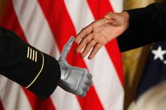 July 12, 2011. President Barack Obama shakes the prosthetic hand of U.S. Army Sgt. First Class Leroy Arthur Petry of Santa Fe, N.M., who received the Medal of Honor for his valor in Afghanistan in a ceremony in the East Room of the White House in Washington. Petry lost his right hand as he tossed aside a live grenade during a 2008 firefight in Afghanistan, sparing the lives of his fellow Army Rangers.