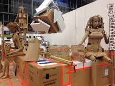 giant puppets made from cardboard on horecava amsterdam rai cardboarders.com and giant recycling logo too!