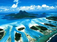Bora Bora, Tahiti - Something is really wrong with anyone that wouldn't wanna visit this stunning spot on earth.