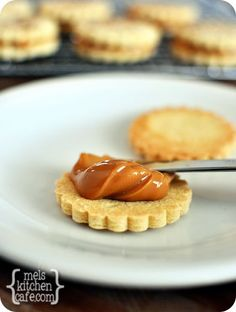Dulce de Leche Cookies from @Melanie Bauer G (Mel's Kitchen Cafe) on chef-in-training.com ... these cookies look AMAZING! #recipe #cookie #bloggercookieexchange