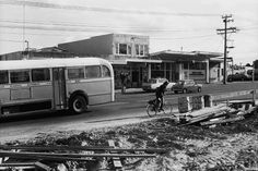 Auckland Regional Authority bus at Gt Nth Rd, New Lynn, Kelston Library stationers, New Lynn Upholsterers and New Lynn Motors (extreme right), with roadworks in the foreground Nz History, Old West, Auckland, Buses, Regional, Kiwi, Coco, Motors, Old School