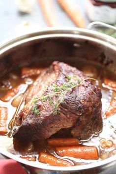 Braised beef brisket is slow cooked with vegetables and a perfect sweet and savory sauce: a perfectl dinner and it couldn't be simpler! lemonsforlulu.com