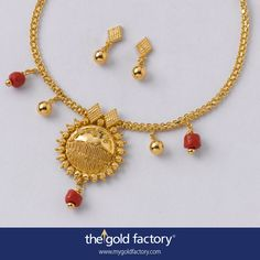 A Manipuri and wire centrepiece with a sun-like motif attracts the eye in this finely detailed necklet. Thokai barfis, polished ball and ganthai pola --- one of which hangs below the pendant --- balance the ornament and make it interesting. With matched barfi eartops, all handmade in 22K gold in the lightest possible weight. Necklace - 9.000 gm and price Rs.33,550/- Earring - 2.500 gm and price Rs. 9,200/-