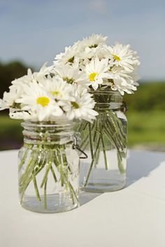 These Mason Jars @Carly Lavin?  How about with a twine/tan ribbon in a knot around it?