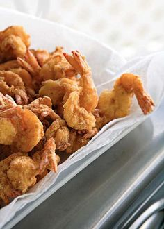 Bayou Fried Shrimp - 100 Ways to Cook Southern - Southernliving. Recipe: Bayou Fried Shrimp For these Cajun-flavored fried shrimp, peel the shrimp but leave the tails on and coat the shrimp in fish fry mix to get a crispy brown coating. Fried Shrimp Recipes, Cajun Recipes, Seafood Recipes, Cooking Recipes, Supper Recipes, Cajun Cooking, Fish Recipes, Creole Cooking, Cajun Food