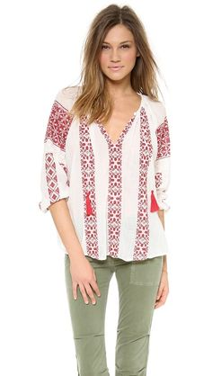 red and white embroidered top