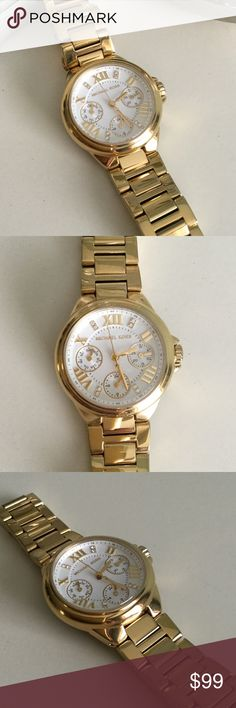 MIchael Kors beautiful gold tone watch Excellent condition,like new, worn only a few times. Face in perfect condition no scratches. Needs a battery. No box or original packaging. Beautiful classic time piece. KORS Michael Kors Accessories Watches