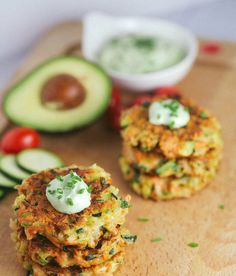 Crispy Vegetable Fritters with Avocado Yogurt Sauce - This recipe is packed with broccoli, carrots, and zucchini. Enjoy by dipping each appetizer bite into a delicious creamy sauce Healthy Vegetable Recipes, Vegetable Dishes, Healthy Snacks, Vegetarian Recipes, Cooking Recipes, Sauce Recipes, Vegetable Appetizers, Vegetarian Dish, Easy Recipes
