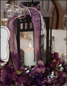 Get black lanterns like this, and add ribbons and flowers around it