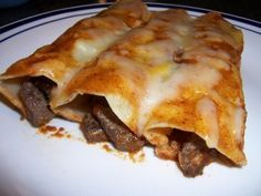 Mexican Style Carne Asada ( Steak ) Enchiladas in Red Sauce. Possibility for when the boys come over?