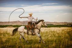 Badlands Spring Workshop 2012 by Rikk Flohr, via 500px | Cowboy, Paul Kruse shows off some whip tricks.