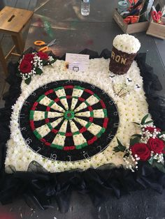 Dartboard and pint of beer funeral flower tribute