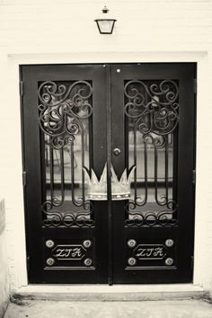 ZTA Housing - The doors of the Epsilon Chapter House at University of Arkansas bears a crown, one of the symbols of ZTA.