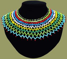 Traditional African Beaded Necklaces handmade by highly skilled Zulu Beadworkers from South Africa. African Jewelry including beaded bangles, bracelets and earrings. African Beads Necklace, African Jewelry, Zulu Wedding, Maxi Collar, Shoulder Necklace, African Accessories, Jewelry Accessories, African Crafts, African Men Fashion