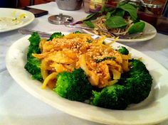 Lemongrass curry coconut chicken at Nam Phuong, served with a ton of onions, broccoli and peanuts on top.