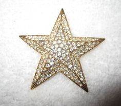 One of almost 40 pins we bought at the Joan Rivers' estate auction--The Big Star! (What could be more fitting?). These were her favorite pins that she actually wore, from her personal jewelry box! These pins make wonderful gifts or treat yourself to a piece of history from a true queen of comedy, wonderful designer and savvy business woman. All beautiful, all conversation pieces, all fascinating collectibles and all high quality jewelry!