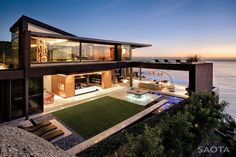 Dream Homes | HomeDSGN, lounge area on upper level (would put glass around it for safety).
