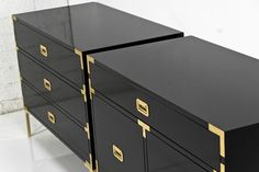 Black lacquer on these campaign trunks is so smart. Jet Setter Side Tables