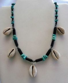 This 18 inch necklace is strung with cowrie shells, tubular black onyx beads and turquoise chips finished with a lobster claw clasp. $26
