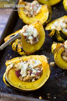 Roasted Squash w/ Pear & Blue Cheese ~ :: Ingredients :: 3 acorn or carnival squash (acorn squash are sweeter) 2 tablespoons olive oil 1 ripe pear, any variety 1/2 cup chopped walnuts 2 tablespoons brown sugar 1/8 teaspoon ground cumin 2/3 cup crumbled blue cheese Salt and pepper