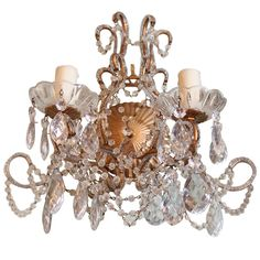Pair of Two Light Gilt Metal & Crystal Sconces | From a unique collection of antique and modern wall lights and sconces at https://www.1stdibs.com/furniture/lighting/sconces-wall-lights/
