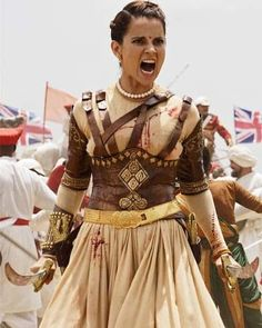 Manikarnika - The Queen of Jhansi is upcoming Bollywood movie which is directed by Krish, starring Kangna Ranaut as The Queen of Jhansi. Queen Aesthetic, Aesthetic Clothes, Warrior Princess Costume, Ballet Hairstyles, British Costume, Steampunk, Warrior Queen, Illustrations, Bollywood Fashion