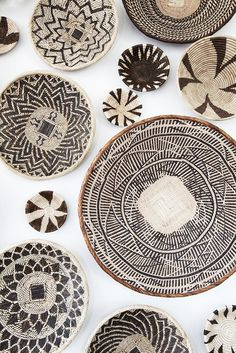 African basket wall art installation I created from baskets I gathered in Zambia, South Africa, Namibia, and Botswana. #chicvilleusa