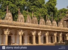 Ornately carved stonework of a colonnade surrounding the courtyard of the Hutheesing Temple in Ahmadabad, Gujarat, India. Stock Photo India Architecture, Temple, Carving, Stock Photos, Illustration, Image, Indian, Architecture, Temples