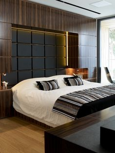 Recessed headboard wall with lighting and storage http://www.bocadolobo.com/en/inspiration-and-ideas/