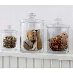 Shop Set of 3 Glass Canisters. Simple bathroom storage with a retro feel. Handmade glass canisters with nesting lids update a classic apothecary look. Glass Shelves In Bathroom, Floating Glass Shelves, Laundry Room Shelves, Small Laundry Rooms, Shelving Design, Shelf Design, Shelving Ideas, Regal Design, Glass Canisters