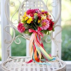 From vintage handkerchiefs to strands of pearls, adorn your bouquet in more than basic ribbon.