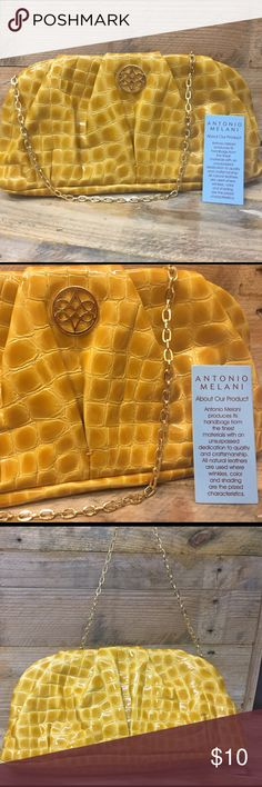 Adorable Antonia Melani Clutch/Shoulder Purse Stylish alligator yellowish gold faux leather shoulder purse with gold chain strap that can be tucked inside and purse becomes a clutch. Used this purse twice and I still have the Antonia Melani tag in pocket. Pocket inside to hold your loose items. Check out other items in my closet to bundle and save. Smoke free home ANTONIO MELANI Bags