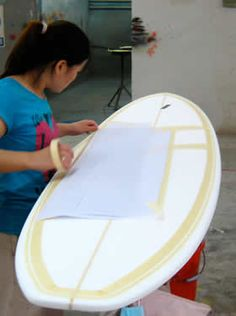 Preparing the surfboard for spray painting- For the girls surf room