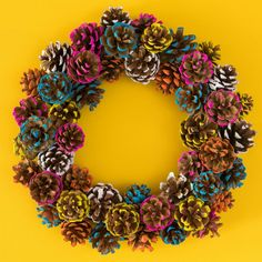 DIY Colorful Pine Cone Fall Wreath - Sarah Hearts : Add color to your fall and holiday decor by making this paint dipped pine cone wreath! Learn how to make a colorful pine cone fall wreath that is perfect for both Thanksgiving and Christmas. Wreath Crafts, Diy Wreath, Fall Crafts, Holiday Crafts, Arts And Crafts, Decor Crafts, Diy Crafts, Fabric Crafts, Wreath Making