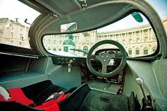 Porsche 917 cockpit. Not many offices offer a Mach 0.3 view. At ground level.