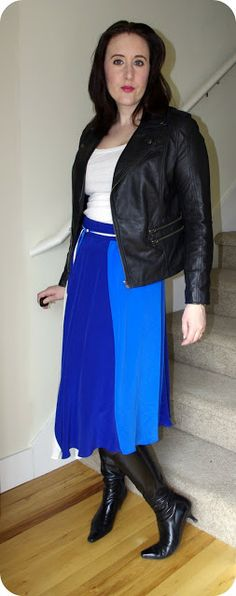 I adore this soft blue skirt with the hard elements of the leather jacket and boots.