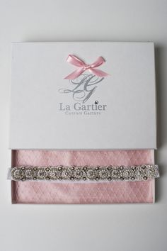 The Lori Wedding Garter. A perfect mixture of pearls and sparkling rhinestones. Now available for purchase on the website at www.lagartier.com