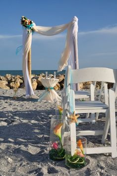 Just by adding simple cylinder floral accents and yoru choice of color accented ribbon you can create a beautiful beach ceremony ~ just as we did on Captiva Island