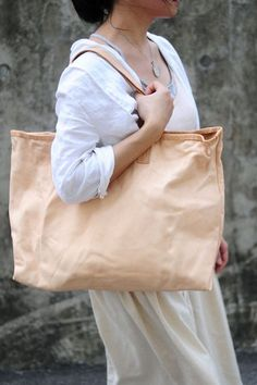 Hand stitched washed out leather tote bag