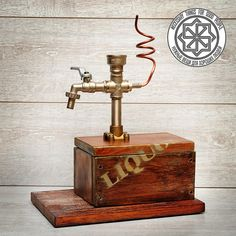 Liquor dispenser Beverage dispenser Tabletop drinks dispenser is made in the direction of fashion now steampunk, loft, industrial.The base is made of larch with the use of brushing and giving a vintage look.Covered with stain colorMoccaand a silver glaze.In the case of a box base to place the