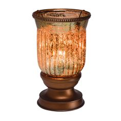 "Rich amber glass with a bronze interior, dappled by flecks of soft light. 8.5"" tall, 25 w"