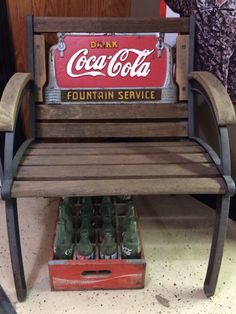 My husband took frame of old bench, added new wood and the Coca Cola sign to make this piece.