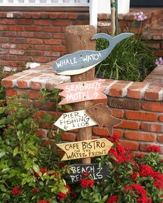 Then there's the garden yard stake from thisNantucket Style California Cottage. I love theWooden Whale Cutout!
