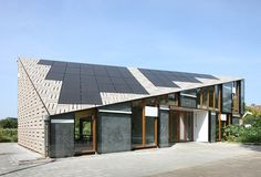 bureau SLA designs the nature and environment learning center in amsterdam Sustainable Architecture, Architecture Photo, Sustainable Design, Modern Architecture, Pavilion Architecture, School Architecture, Residential Architecture, Solar Energy Panels, Solar Panels For Home