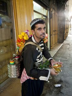 Mustafa sells Sousse, a licorice drink, as he winds through the back alleys in the Aleppo souq on a summer day.