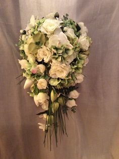 Artificial Green Orchids and Ivory roses shower bridal bouquet. by Cathey's flowers