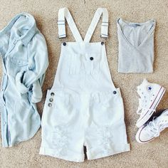 "Sweet distressed details adorn these darling laid-back overalls. A soft white denim pairs with traditional overall styling, rolled hem shorts, distressed details, and a cross-over back. Tailored design for a non-bulky fit, these overalls are perfect paired with a tee for spring & summer.  Color: Soft white denim 98% Cotton & 2% spandex Imported Hand or machine wash cold Inseam:  4"", Waist S 32"", M 34"", L 36"""