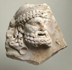 Relief with a mask of Dionysos.  Date: ca. A.D. 40–70   Medium: White, fine-grained marble
